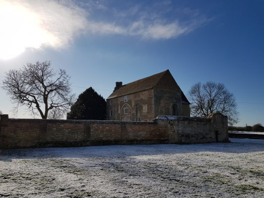 Denny Abbey surrounded by snow